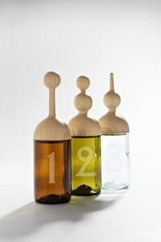 vetro collection: a lovely and fun collection of table accessories and lighting made from recycled bottles' glass combined with woodworking.