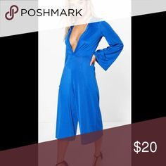 Plunge neck culotte jumpsuit Slinky material and very flattering! Perfect with a cute belt and a choker! Sizes available uk:10/us:6 uk:12/us:8 Pants Jumpsuits & Rompers