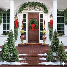 I love the simple free and red... I'd like longer garland and get rid of the urns/trees/teardrops.  Simple with white lights would be perfect!