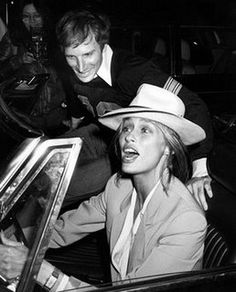 A young Lauren Hutton in a very chic fedora and suit. How does she keep her hat on in that convertible?