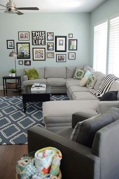 Darker gray accent chair and incorporate blues into rug or throw pillows