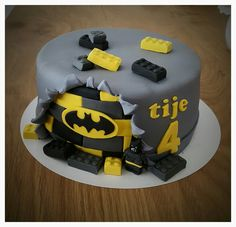 Lego batman cake / taart - Simple but beautiful love the added Lego bricks and the exposed bat symbol.