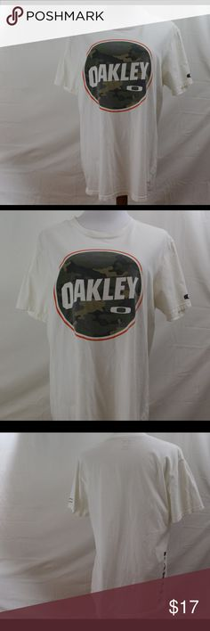 Men's Oakley Tshirt Oakley Tshirt with camo print and orange design. Left sleeve has the logo and the right lower side has Oakley printed . This has been worn a few times but there are no rips, tears, or stains Oakley Shirts Tees - Short Sleeve