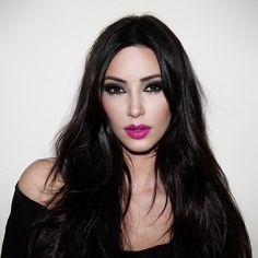 Darker hair, paler skin, smokey eyes, bright lips -- do this look more often, Kim!