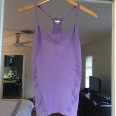 ⛹ Purple NIKE Fit Dry tank in M/L Purple Nike Fit Dry tank in Medium/Large. Made of moisture wicking material and has a built in shelf bra. Tank top has adjustable spaghetti straps and is in great condition. Comes from a smoke free home and ships within 24 hours. Nike Tops Tank Tops