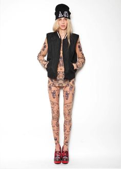 Tattoo top and collant styled with sleeveless jacket