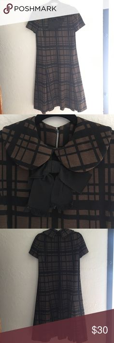 1970s vintage brown and black plaid dress with bow 1970s vintage brown and black plaid dress with bow. Wool. Super cute. Pleated at bottom. Fits many body types. I would guess size 8-10. Gorgeous piece in perfect condition. Dresses Midi