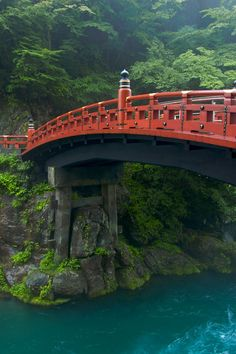 The Shinkyo (sacred bridge), a red lacquered span that arches gracefully across the Daiya River in Nikko Japan