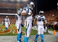 Carolina Panthers quarterback Cam Newton (1) celebrates scoring a touchdown…