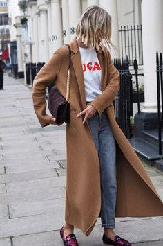 How to dress down a camel coat for autumn winter. Layer graphic logo underneath and then hit multiple trends this year. Women's 2017 street style.