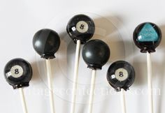 Magic 8 ball edible art lollipops by Vintage Confections  They're really magic!  Each lollipop has a mystery message on the back that reveals itself after you lick it!