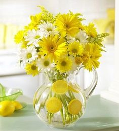 yellow flower centerpieces...will be doing this inexpensive and happy arrangement ALL spring!: