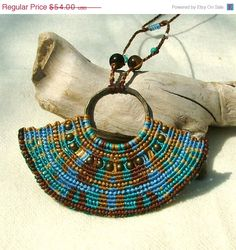 This necklace presents a very fine work of micro macrame , uniquely designed in a beautiful pattern.    The technique is called cavandoli