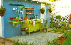 Cute potting stations for the garden area. I like the idea of the hanging rack.