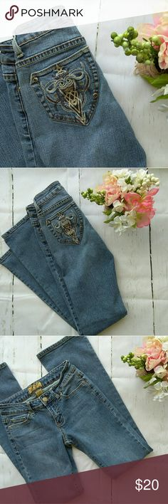 """💥2-4-$30! EUC L.V. Embroidered Boot Cut Jeans 2-4-$30! 7/28-7/31 only!   EUC! L.V. (NOT LOUIS VUITTON!) Embroidered boot cut jeans. Labeled size 3/4, but fit like a 0 (on someone -me- who is 94 lbs, 5'2"""", 24"""" waist/33"""" hips.) Hence the listing size. Beautiful fleur de lis type embroidery on the back pockets! Dress them up for evening, or keep it simple with a plain cami for daytime! These jeans look amazing on, and really flatter the butt, unlike most jeans with pocket design. L.V. Jeans…"""