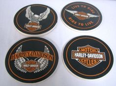 """Hallmark Harley Davidson Collection. Set of 4 coasters with cork bottom. Different Harley symbol on each coaster. Matching case included. Case measures: 2"""" x 4 1/4"""" - Hallmark Harley Davidson Collecti"""