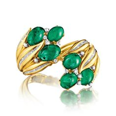 Verdura Hyacinth Bracelet Hinged 18k gold mounting set with six oval cabochon emeralds weighing 75.59 carats and 3.25 carats of round and pa...