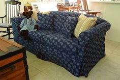 This smart looking sofa slip cover makes a great new resting place for Mr. Bear.