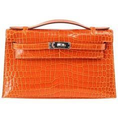 Preowned Hermes Kelly Pochette Clutch Bag Orange Feu Porosus Crocodile... (£33,610) ❤ liked on Polyvore featuring bags, handbags, clutches, orange, croco embossed handbags, hermes purse, croc purse, preowned handbags and hermes pochette