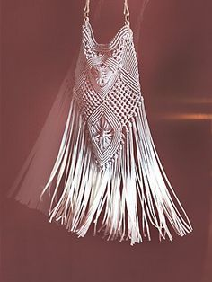 Here's the picture of a bohemian tassel bag. Woven fringe brings bohemian spirit to the slouchy silhouette.