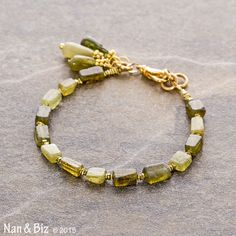 This delicate green garnet bracelet, made of primitive, hand-cut grossular garnet beads separated by tiny, brass Hill Tribe stick spacers, reminds me