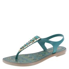 The perfect embellished sandal for warm weather months, the Simba Sling from American Eagle features a flexible jelly upper with gorgeous jewels up the vamp, coordinating printed footbed, and a flexible outsole. Manmade materials.