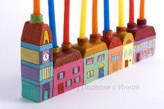 Hanukiah with houses (closeup)