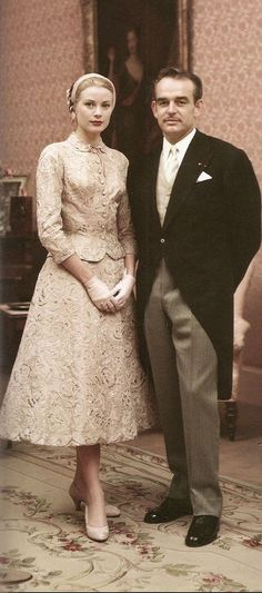 Grace and Ranier's civil marriage ~ Monaco required both a civil and church wedding. On 18 April 1956, they were civally married. Before her official state wedding, Grace wore a rose pink taffeta suit covered in Alencon lace designed by Helen Rose, white gloves, and a Juliet cap.: