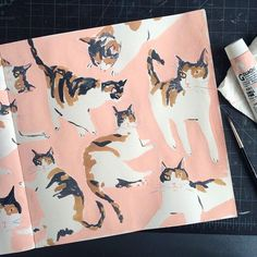 Cat sketchbook pages Leah Goren in a pretty color palette of salmon pink, and other vintage inspired hues.