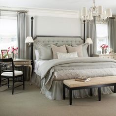Gray tan white bedroom, notice the end tables and the tufted head board...