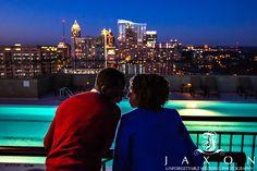 Jaxon Photography, Atlanta wedding photographers. Twilight engagement pictures at roof top at Georgian Terrace Hotel in Atlanta,  looking north towards mid-town Atlanta