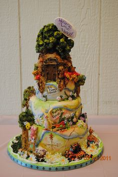 100 Acre Woods Shower Cake - Cake is a map of the 100 Acre woods.  All characters are modeled from Gumpaste/Fondant (60/40) Pooh's house and all trees are made from Rice Krispies treats covered with royal icing