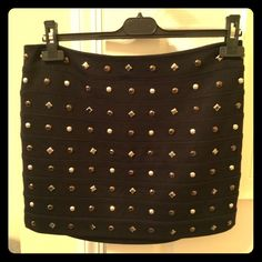 Express black jeweled mini skirt Adorable mini skirt that looks great with heels, or leggings and boots. A few of the jewels have fallen off and been sewed back on. Good used condition. Express Skirts Mini