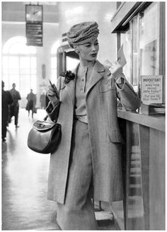 "Ghislaine Arsac in travel ensemble by Madeleine de Rauch, hat by Svend, purse by Duc,1956 ""From Sophia Book"" (Photo Philippe Pottier)"
