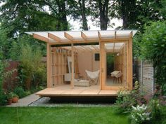 Little Tiny Houses- this one has the kind of roof I want on mine-- lets the light in!