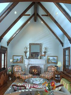 Like the mix of beams and white walls with the plaid chairs and fireplace.