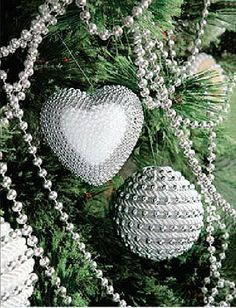 This heart ornament and round ornament are both made using bead garlands and rope trim over foam bases.  These are stunning and easily customized for any style (except rustic, maybe.)  FYI: this site is not in English.