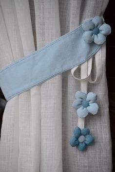 Pretty blue flower tie backs for curtains. #tiebacksforcurtains