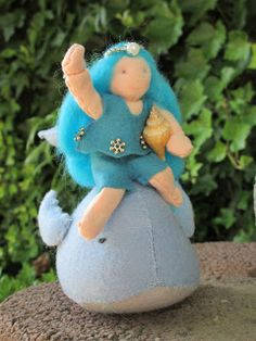Waldorf doll on whale, by Nicole doet haar ding