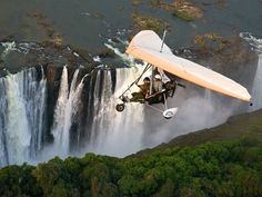 microlight flight brings adrenaline junkies close to the roar of Victoria Falls, which splashes between Zambia and Zimbabwe.