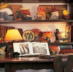 Shelves in a guest bedroom display Keaton's collections of Mexican and California memorabilia, including cement lawn ornament figures.