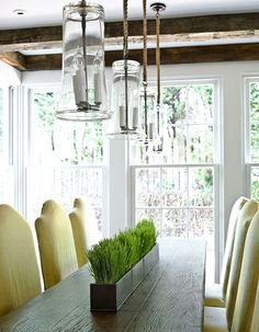 breakfast room with citrine chairs potted grass centerpiece rustic beams and glass pendants Grass Centerpiece, Interior Design Pictures, Elegant Centerpieces, Green Centerpieces, Traditional House, Dining Area, Dining Rooms, Dining Table, Room Inspiration