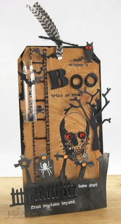 Create With Me: A Halloween tag made using dies, rub ons and other Tim Holtz products.