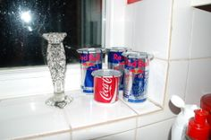 pop cans i made in to plant pots