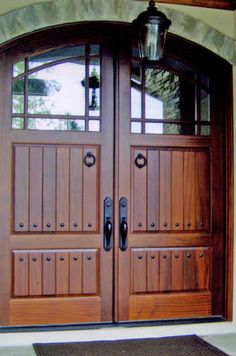 Custom craftsman double entry wood door.