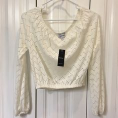 BRAND NEW BEBE LACE CROP TOP New with tags! Bebe lace, off the shoulders, crop top! Size small but could fit Medium as well. Elastic band across top and bottom to stay in place. Lace is sheer. bebe Tops Crop Tops