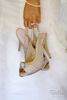 The key to good wedding shoes is how they look being carried around