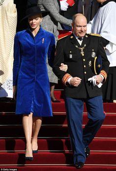 Princess Charlene of Monaco looked glamorous in a velvet blue coat dress as she joined hus...