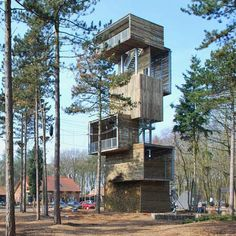 Viewing tower by Ateliereen Architecten. 25 metre tall viewing tower at an outdoor sports park in Reusel, the Netherlands. The structure comprises six boxes resting on a steel, structural core and incorporates abseiling and climbing facilities.