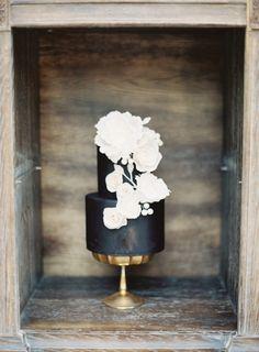 Black cake with bold white flowers: http://www.stylemepretty.com/2015/01/29/moody-romantic-outdoor-wedding-inspiration/ | Photography: Kurt Boomer - http://www.kurtboomer.com/